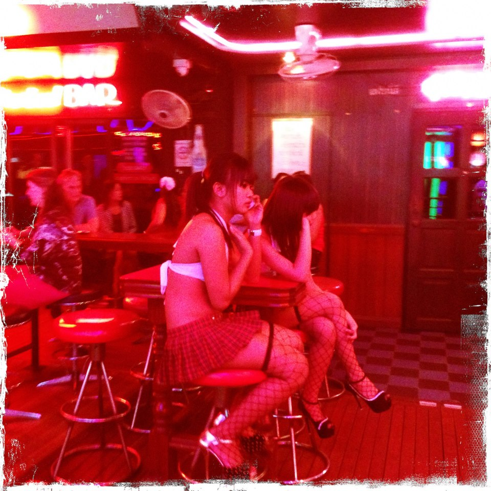 """Inside the bars girls solicit """"lady drinks"""" and offer a night of company"""